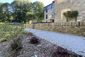 Dry stone walls at Empire Works, new homes Huddersfield, by house developer SB Homes
